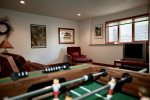 Play foosball and watch your favorite show in the lower living space