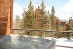 Enjoy a soak after a long day in the private hot tub