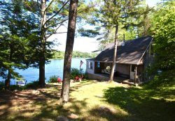 Serene, picturesque cottage on private lake with dock