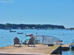 Classic Farmhouse directly on Port Clyde Harbor with large lawn, private wharf and boat house