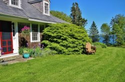 Classic Maine summer home on bold ocean frontage, large lawn.