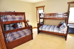 Captain bunk beds with a twin bed on top and a double bed on the bottom.