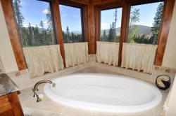 Relax in a nice hot bath as you enjoy the surrounding mountains.