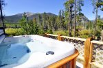 Enjoy a relaxing time in the hot tub located on the deck.