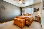 Master bedroom with king bed and ceiling fan for summer nights