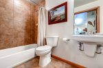 Guest bathroom with full tub and shower located off the hall