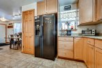 Kitchen with standard 12 cup coffee maker, toaster oven, and microwave