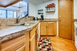 Kitchen is equipped with cookware, utensils, & flatware