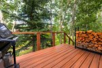 Back deck with extra firewood and gas grill