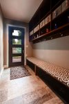 Mudroom with heated floor, bench and cubbie storage
