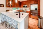 Gorgeous cook`s kitchen with breakfast bar seating for 4