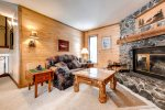 Family room with wood fireplace, sofa and TV, games, puzzles