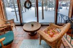Sun room is access via sliding door from the family room - winter view