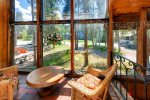 Sun room is access via sliding door from the family room - summer view