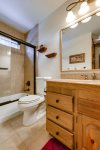 Full bathroom with tub and shower on the second level is shared by guest rooms 1 and 2
