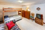 Lower level bunk room - large room with sofa and tv - great for kids