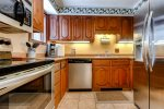 The kitchen is fully equipped with stainless steel appliances and refrigerator, oven, dishwasher and stove.