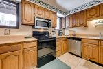 Kitchen with stainless steel appliances: microwave, refrigerator, stove updated photo of new stove coming soon