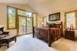 Master bedroom on main level - French doors lead to private deck with ski area views