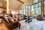 Living Room on Main Level - Luxe mountain modern furnishings and floor to ceiling windows with mountain view
