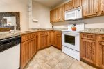 Fully Equipped Kitchen with Granite Countertops