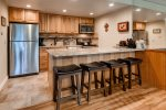 Newly remodeled kitchen with granite countertops and stainless steel appliances and seats 4 at the counter