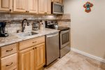 Fully remodeled and equipped kitchen with stainless steel appliances, dishwasher, oven, electric stove, microwave