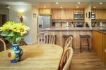 Dining tables seats 6 with new hardwood floors and opens up to a private deck with gas grill