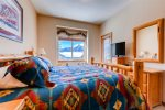 Master bedroom with King bed and 27 flat screen tv and private ensuite and access to shared deck with second bedroom
