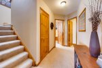 Lower level hallway looking towards bunk room left and shared bathroom right