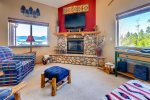 Living room with large flat screen tv, cable and wifi