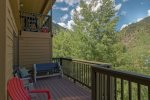 Relax on the private deck with mountain views and listen to Tenmile Creek below