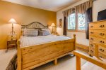 The master bedroom comes equipped with a sleep number bed, ceiling fan and flat screen tv