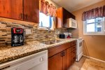 The kitchen is recently updated and comes equipped with a coffee maker, dishwasher, refrigerator, electric stove and oven