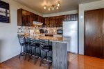 The kitchen has 3 barstools at the kitchen counter. The kitchen has new granite counters, and is fully equipped with all of the flatware, cookware, and utensils you need to prepare meals.