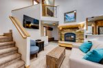 A flight of stairs from the main level living room go up to the private deck with hot tub and master bedroom and ensuite