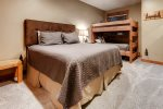 2nd bedroom with queen bed and bunk