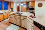 Gourmet kitchen with built in cook top and utility sink in the island. Walk in pantry and plenty of counter space to prepare meals.