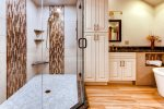 Full en-suite mater bath with stand up glass shower