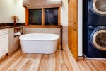 Full en-suite master bath with deep soaking tub and second washer and dryer