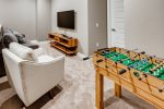 Bonus room with foosball table that converts to play other games