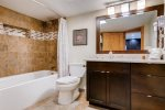 Bathroom located off the hall, hair dryer included
