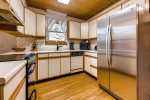 Kitchen with new full size refrigerator and stove