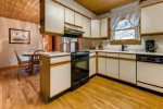 Kitchen is furnished with standard coffee maker, microwave, toaster, dishwasher, cookware, and flatware