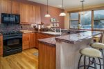 Fully stocked kitchen with stainless steel appliances and granite countertops