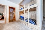 Lower level living area with built-in bunk beds that sleeps 2