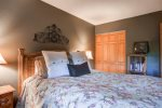 Master bedroom with a comfy queen bed.