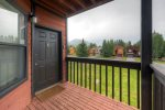 Private balcony with gas grill and mountain views.