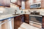 The kitchen has recently been fully remodeled and features stainless steel appliances and granite countertops