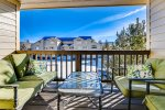 Enjoy the fresh mountain air on the 1st balcony located off the living area